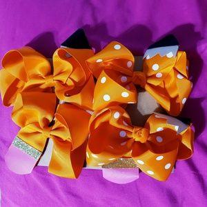 Four Orange Pencil Hair Bows